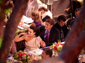 Couple smile at rehearsal dinner table
