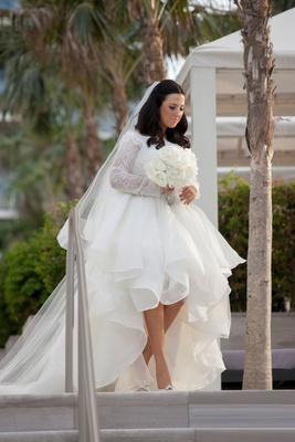 custom rivini wedding dress from kleinfeld, high-low skirt, long lace sleeves