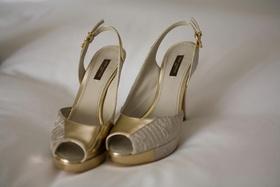 Asymmetrical Louis Vuitton gold slingback heels