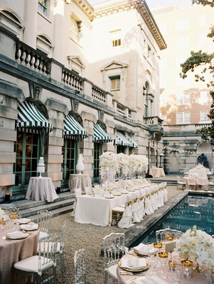Wedding reception at Anderson House in Washington DC around pool white long table pink round table
