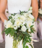 bridal bouquet white flowers and greenery bridesmaids in back