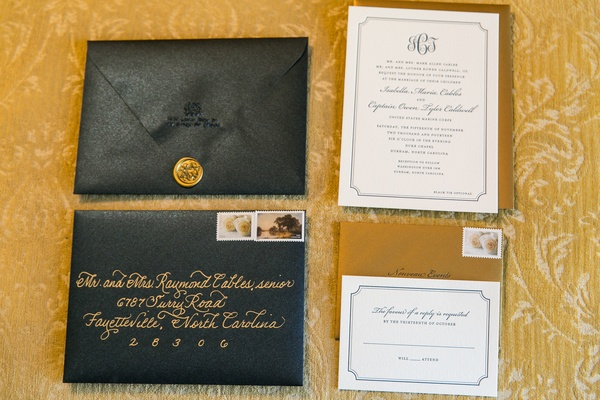 Yellow and black wedding invite with gold seal and calligraphy