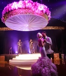 Bride in a fit-and-flare Vera Wang dress, ruffled skirt dances with groom, Boyz II Men