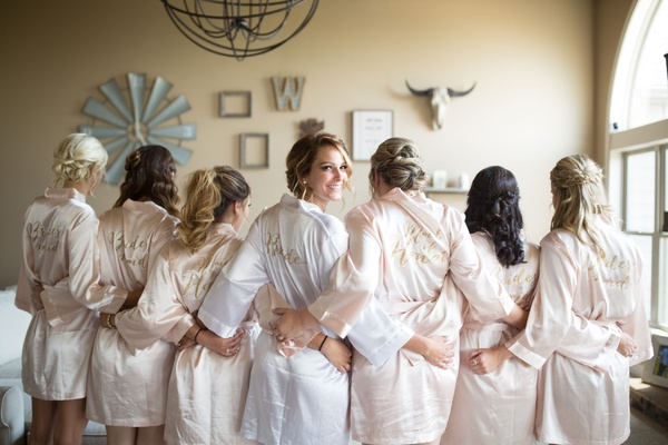 bride and bridesmaids in embroidered robes, champagne bridesmaid robes