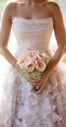 DFW Events bride Chloe wears a stunning blush ballgown by Romona Keveza.