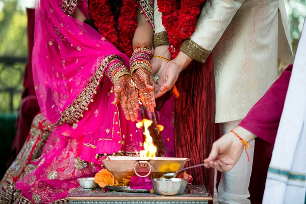Bride and groom partaking in traditional Hindu wedding ceremony with special customs and rituals