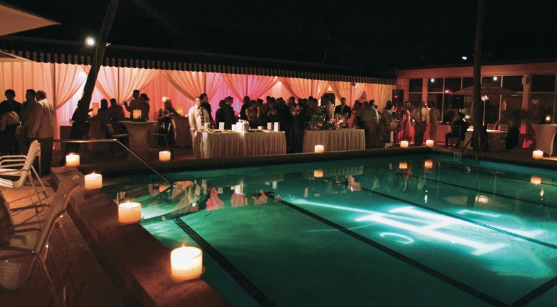 swimming pool surrounded by candles and lit with monogram