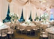 Ballroom wedding in Chicago with drapery on windows and ceiling green and white centerpieces silver
