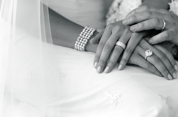 Black and white picture of bride and groom jewelry