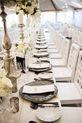 long reception table metallic chargers grey white florals roses greenery simple chairs