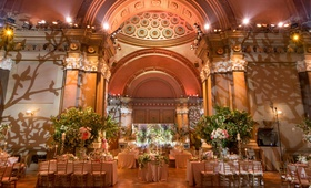 Wedding reception lighting projections vines trees weylin brooklyn greenery bright flowers
