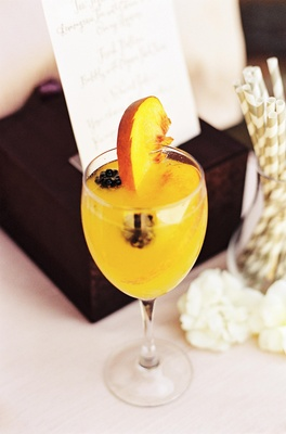 Peach Bellini cocktail with fresh fruit