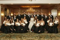 Bride and groom with many bridesmaids and groomsmen at Four Seasons