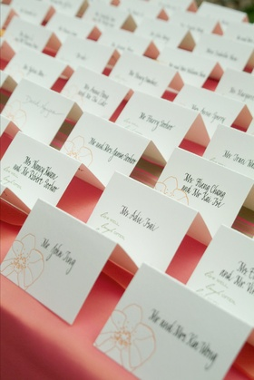Place card with orange orchid design