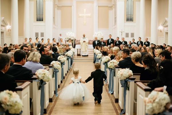 Flower girl in white tulle dress with ring bearer walk down Perkins Chapel aisle for church ceremony