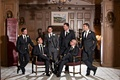 groomsmen wear black suits and white boutonnieres