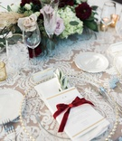 lace linens at reception, menu tied with red velvet ribbon