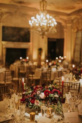 wedding reception table low centerpiece burgundy flowers dahlias blush roses greenery fruits gold