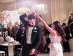 manny smith interscope wedding, groom smiles during spin during first dance