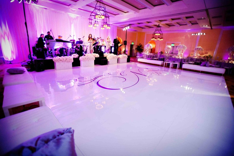 Monogram dance floor with purple lighting and lounge furniture