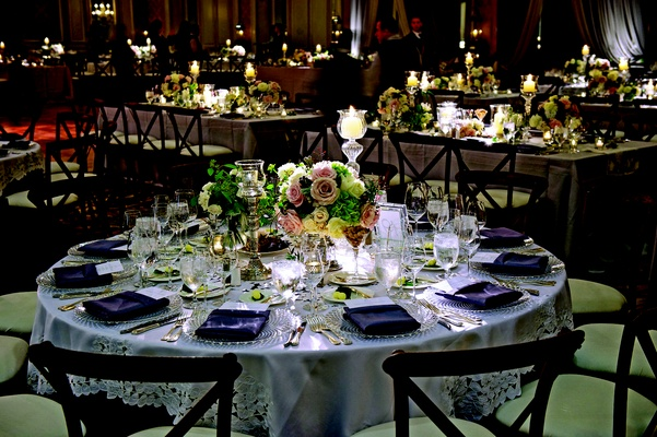 Short floral arrangements and crystal candlesticks