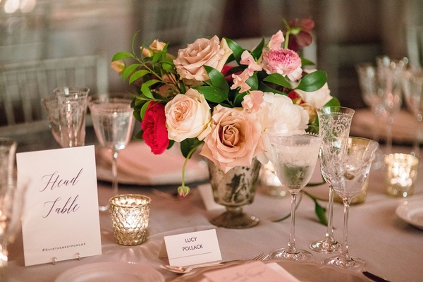 Head table grey reception table candle votive pink roses flowers greenery silver vase simple