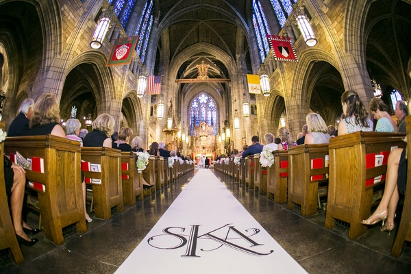Wedding monogram on church ceremony aisle runner