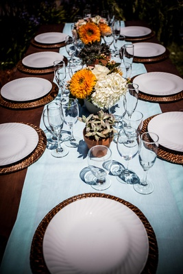 Rattan charger plates with light blue table runner