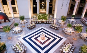 wedding reception at the field museum in chicago navy white stripe dance floor cake in center