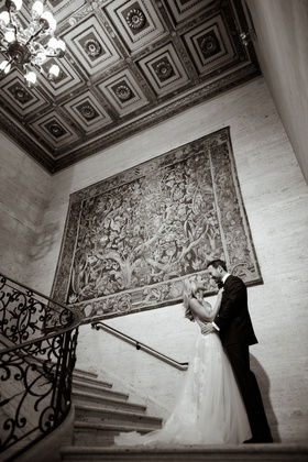 Black and white photo of bride and groom in chicago at the standard club tapestry ceiling chandelier