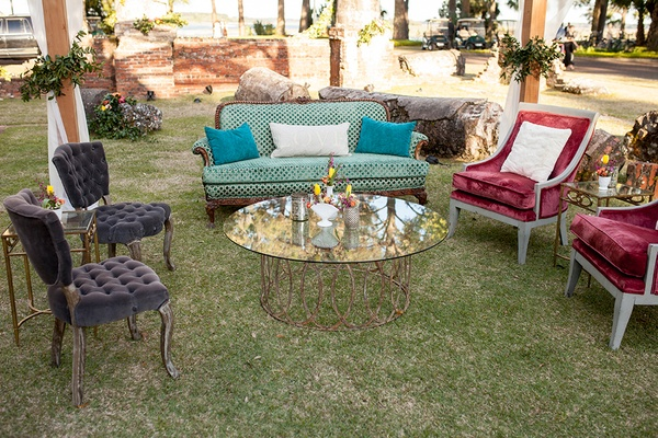 Glass table with copper legs antique vintage inspired sofa armchair accent under canopy lounge