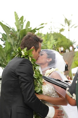 Angus Mitchell, co-owner of Paul Mitchell Systems, kisses his bride at their Hawaiian wedding
