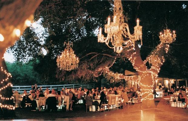 Evening reception illuminated by hanging lights