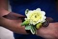 White dahlia and fiddlehead fern wedding corsage