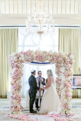 wedding ceremony ballroom blush and white rose flower chuppah chandelier casa del mar