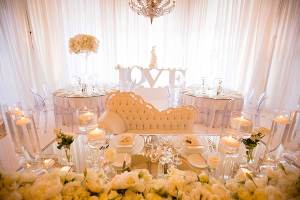 mirror top sweetheart table loveseat flowers candles metallic glass love table drapes