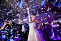bride dancing onstage confetti classic dallas wedding reception fun wild exciting performing singing