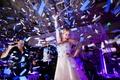 bride dancing onstage confetti classic dallas wedding reception fun wild exciting performing singing