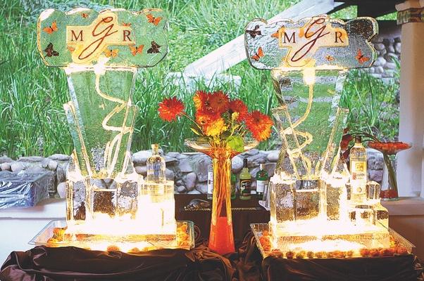 Martini ice bar dispenser with orange butterfly design