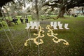 White and ivory rose petals on grass at Plantation wedding