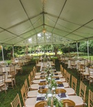 tented wedding reception on lawn, gold chiavari chairs, gold chargers, open air tent
