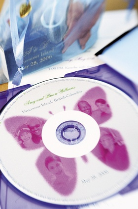 Personalized wedding CD decorated with a pink butterfly and photos of the bride and groom