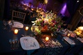 floral centerpiece on table with blue linens and candles