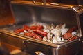 Silver buffet tray with sausage and clams for rehearsal dinner
