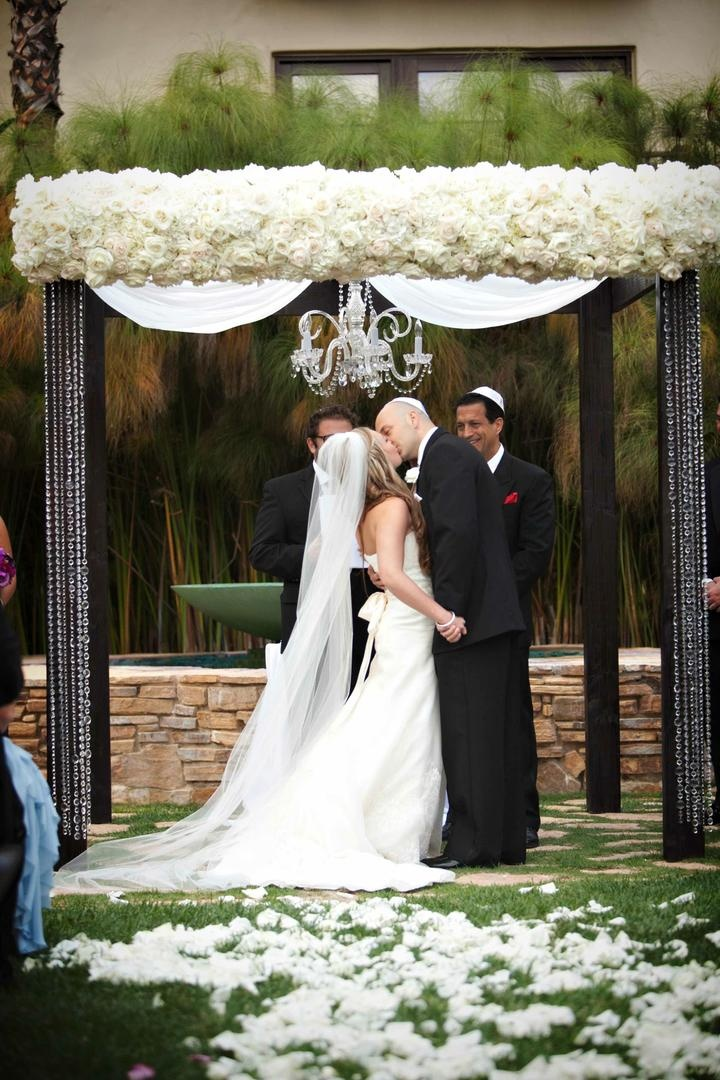 White rose chuppah with chandelier and crystal strands