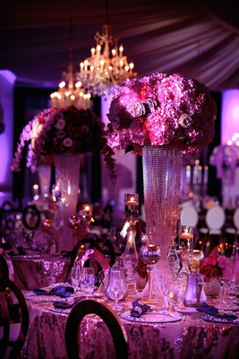 wedding reception centerpiece crystal riser candle votives hot pink purple flowers