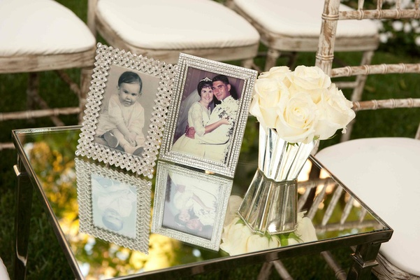 Crystal frames with old family photos on mirror table