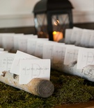 escort cards branched tree trunks moss