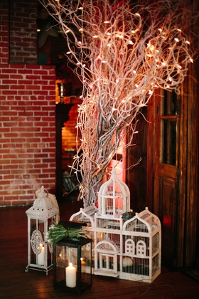 Branches at wedding with birdcage and Moroccan lanterns