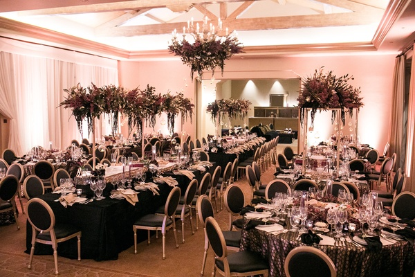 Hindu and sikh ceremonies formal reception in orange county modern wedding reception with black linens black chairs dark purple florals kings tables junglespirit Gallery